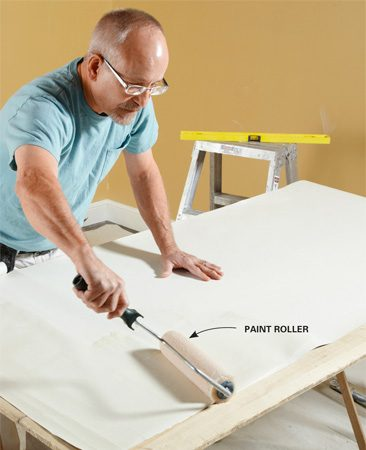 <b>Apply paste with a paint roller</b></br> Use a high-quality 1/2-in.-nap paint roller cover to apply paste—the cheap ones will leave fuzz balls behind.