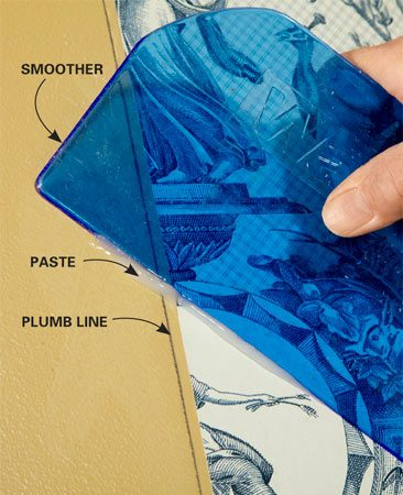<b>Use a smoother</b></br> Run a smoother over every square inch of the paper. Don't push too hard and squeeze out the paste or stretch the paper.