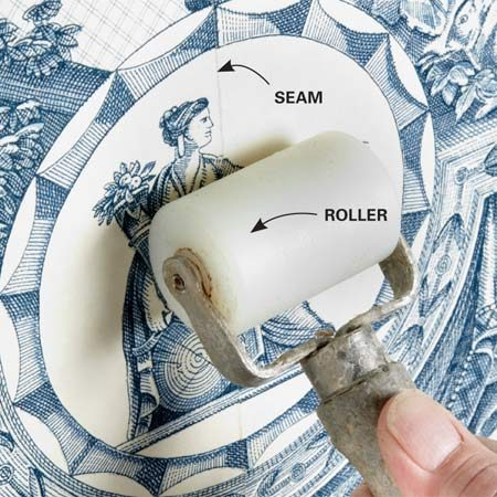 <b>Set your edges with a roller</b></br> Don't press too hard and squeeze out too much adhesive.