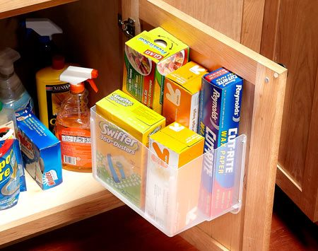 <b>Keep frequently used stuff accessible</b></br> <p>What's hiding under your kitchen sink? If the space under your sink is anything like ours, it's an overcrowded jumble of cleaning supplies, sponges and plastic bags. I came up with a great way to store these items right on the door of the sink cabinet. I cut a plastic storage tub in half with a utility knife and screwed it to the inside of the cabinet door through the plastic lip at the top of the tub. Just make sure you position it so you can shut the cabinet door when all your bags and other supplies are in the bin.</p>  <p>Alexy E. Pagan<br> Field Editor</p>