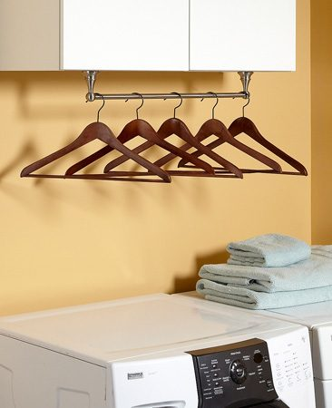 <b>Avoid wrinkles </b></br> <p>If you have shelves or cabinets above your washer or dryer, you've got the perfect spot to store clothes hangers. Just mount a towel bar to the bottom of the cabinets. This puts hangers at your fingertips so you can hang up shirts and slacks fresh from the dryer.</p>  <p>Jeff Gorton<br> Associate Editor</p>