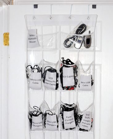<b>Until they make a universal charger...</b></br> <p>We got tired of rummaging through drawers and boxes trying to find the right cords and chargers for all of our electronic gadgets. Our solution was to use a clear vinyl over-the-door shoe organizer. We made labels for each pocket and put every item in its new home. Now we can find everything we need without getting frustrated.</p>  <p>Peggy Kolar<br> Field Editor</p>