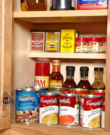 <b>Store small stuff up high</b></br> <p>Spices are a pain to store. They get easily lost in your cabinets, so you end up buying duplicates when you can't find what you need. Here's a simple solution. Pick up a bag of adjustable shelf supports and a 1x4 board at a home center. Just measure the height of your tallest spices, measure down from your shelf, drill holes and mount your spice shelf on shelf supports. You'll put an end to buying three tins of poultry seasoning and more bay leaves than you'll use in a lifetime.</p>  <p>Gary Wentz<br> Senior Editor</p>