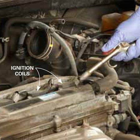 <b>Photo 1: Blow away the crud</b></br> Blast compressed air around the ignition coils to prevent crud from falling into the cylinders. Then blow any remaining loose dirt off the engine before you set out your tools and new plugs.