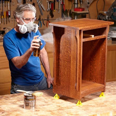 <b>Spray on the final coat</b></br> <p>Here's a trick for getting a glass-smooth finish on your next  woodworking project. Start by brushing on a coat of gloss polyurethane. Let it  dry overnight. Then lightly sand with 320-grit sandpaper to remove imperfections.  Use a tack cloth or vacuum cleaner and soft brush attachment to remove the  dust. Repeat this process for the second coat. Finish up by spraying on the  final coat. You can buy aerosol cans of polyurethane in satin, semigloss and  gloss finishes. Any of these can go over the gloss coats.</p> <p>Brushing on the first two coats allows you to build up a thicker  layer of finish with less cost and effort than spraying from cans. And using an  aerosol can to apply the final coat produces a professional-looking finish,  free of brush marks. We used Minwax polyurethane because we were able to buy  the same finish in liquid and aerosol versions, and the aerosol can has a high-quality spray tip.</p>