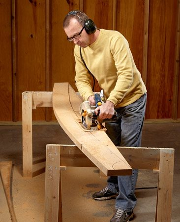 <b>Photo 3: Cut the arches with a circular saw</b></br> On a gentle curve like this one, a circular saw is faster and easier to control than a jigsaw. Take your time and cut along the outer edge of the mark. Then clean up the cut with a sander.