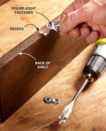 <b>Drill a recess for the figure-eight</b></br> Use a spade bit or Forstner bit to drill a slight recess in the back of the shelf to accommodate the thickness of the figure-eight. Then chisel out the remaining wood until the figure-eight sits flush to the shelf. Attach the figure-eight with a screw.