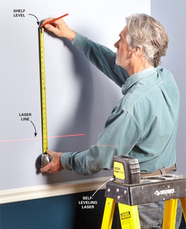 Use the beam as a reference point; then<br> you won't have to reposition it for each shelf.