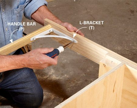 <b>Photo 7: Install the handle bar</b></br> Secure the handle bar by driving screws through each handle into the end of the rail. Add the L-brackets to beef up the connection.