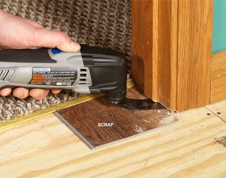 <b>Photo 3: Undercut doorjambs</b><br/>Trim jambs and casing so you can slide the flooring underneath. An oscillating multi-tool works great. Use a small scrap of flooring as a guide.