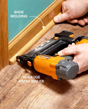 <b>Photo 7: Install bridge molding.</b></br> <p>Cover the expansion gap between the flooring and the base trim.  Don't nail into the flooring—that will prevent the floor from expanding freely. </p>