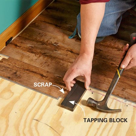 Tap the first plank under the jamb.