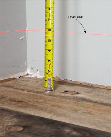 Figuring out where a floor's high and low spots are with a laser level.