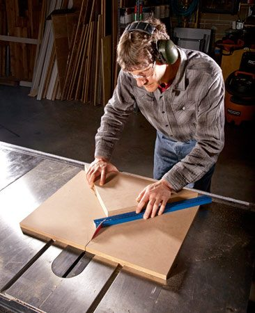 Cutting a 45-degree miter with a 45-degree miter cut table saw sled.