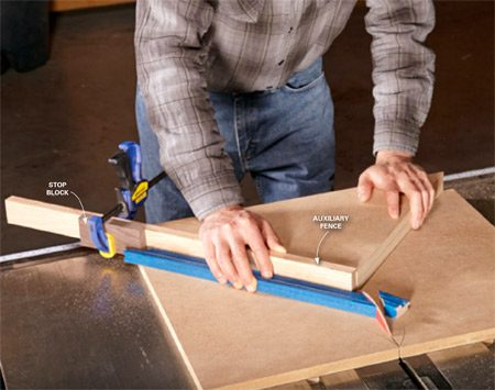 Use an auxiliary fence for precise miter cuts.