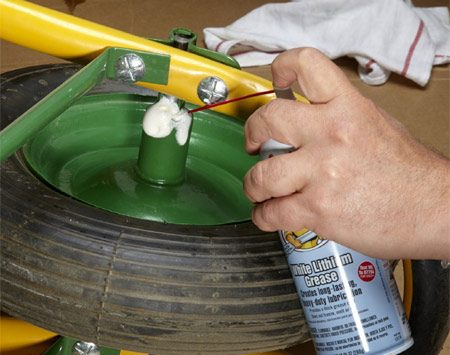 <b>Lithium grease for garden equipment</b></br> <p>Lubricate heavy garden equipment wheels with spray lithium grease. It'll stand up to the load better than oil, silicone or PTFE. Take the wheel off and spread grease on by hand or shoot it with aerosol white lithium grease. Spin the wheel to work the lube into the axle before the solvent evaporates.</p>