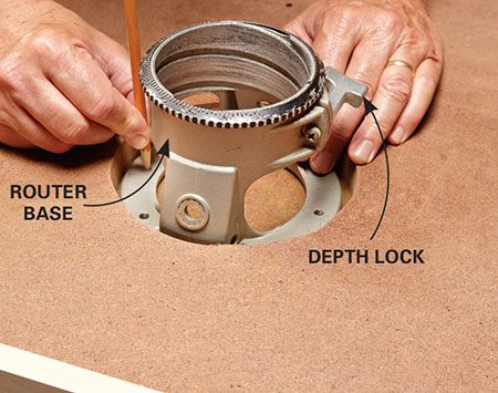 <b>Photo 5: Mount the router base</b></br> <p>Remove the plastic plate and handles from the router base and set the base in the table top. Mark the screw-hole locations and drill holes so you can screw the base to the top. Be sure to orient the base so the depth lock faces the front of the table.</p>