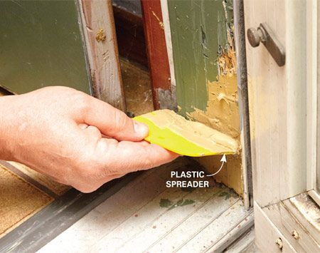 <b>Photo 1: Patch the jamb</b><br/><p>Scoop up the filler with a disposable plastic spreader and force it deep into the cracks on the jamb. Then apply a second, thicker coat to cover the entire repair. Let it harden for about 45 minutes. Then sand until smooth, prime and paint.</p>