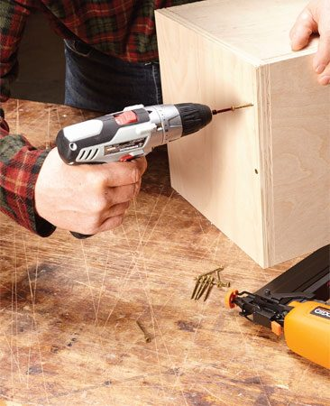 Tacking work pieces into place with a finish nailer.