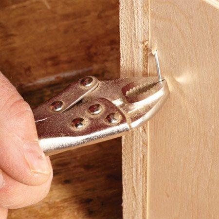 <b>Pull them out or break them off</b></br> Sometimes you can bend errant nails into position to be pounded back out with a hammer. Other times all you can do is break off what you can and use a nail set to bury the rest.