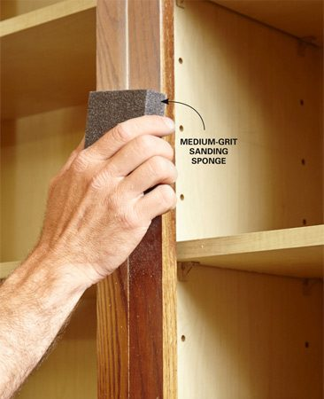 <b>Prepare the cabinets</b></br> <p>After removing the doors and drawer fronts, clean all the face frame and end panel surfaces with denatured alcohol. Then scuff the surfaces with a sanding sponge. Finally, clean again with alcohol.</p>