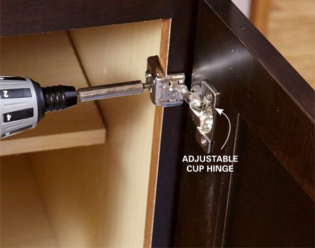 <b>Photo 8: Hang the door</b></br> <p>Line up the center of the hinge with your mark and drill a pilot hole. Then drive a screw through the top hinge plate into the stile. Attach the bottom hinge the same way.</p>