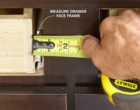 <b>Photo 9: Measure for the drawer front placement</b></br> <p>Measure the distance from the drawer side to the face frame stile. Also measure from the drawer bottom to the face frame drawer rail. Add the overlay distance to these measurements to arrive at the dimension you'll mark on the back of the drawer front (Photo 10).</p>