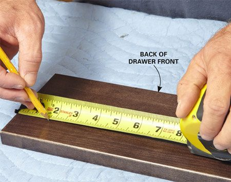 <b>Photo 10: Mark the drawer location</b><br/><p>Use the dimensions you calculated (Photo 9) to mark the back of the drawer front.</p>