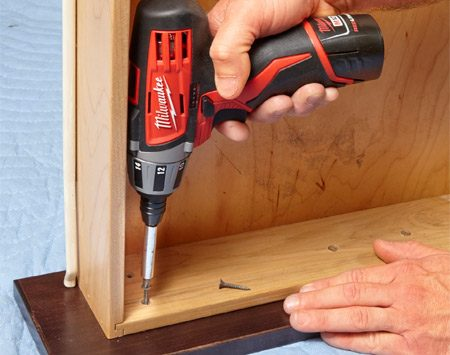 <b>Photo 11: Attach the drawer front</b><br/><p>Align the drawer box with the marks and drive screws through the drawer into the drawer front. Double-check the screw length to make sure the screws won't go through the face of the new drawer front.</p>