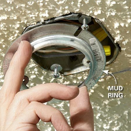 """<b>Photo 3: extend electrical boxes</b></br> Screw a 1/2-in. """"mud ring"""" to any junction boxes in the ceiling. This extends the box so that it will be flush with the new drywall."""