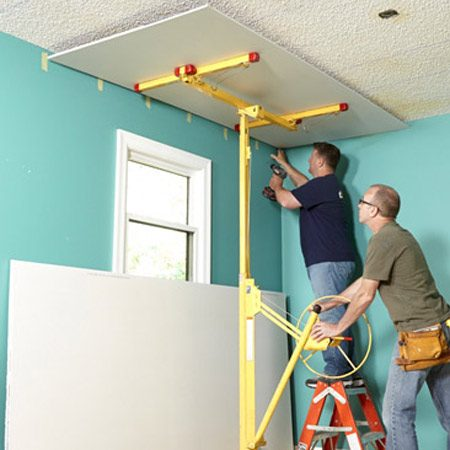 <b>Photo 5: Raise rock the easy way</b></br> Hoist each sheet with a rented drywall lift. Be sure to leave 1/4-in. gaps between the sheet and the wall. Those gaps allow you to slip tear-away bead behind the edges of the drywall bead later.