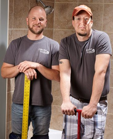 Luxury vinyl tile installers Nate and Andy.