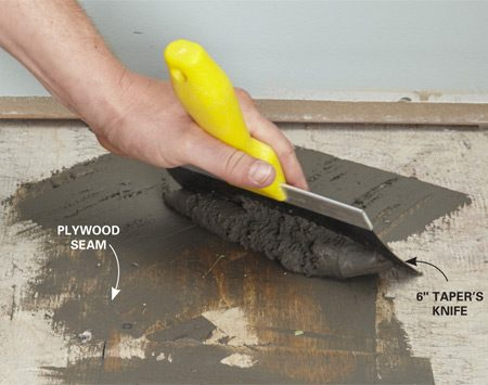 <b>Photo 1: Fill gaps and seams</b></br> <p>LVT will follow the profile of the existing subfloor, so make sure you fill in seams, low spots and large gaps with floor patch.</p>