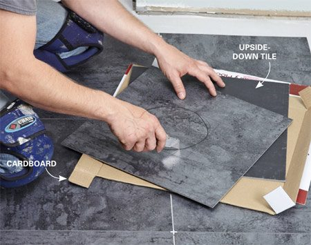 <b>Photo 10: Cut with a utility knife</b></br> <p>You can cut LVT with just a utility knife. That means you don't have to run back and forth to a saw every time you need to make a cut. An upside-down tile and a little cardboard make an excellent cutting station.</p>