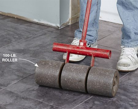 Use a roller when you install luxury vinyl tiles.