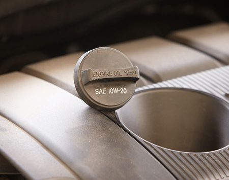 <p>The oil viscosity your car needs might be stamped<br/> on the filler cap.</p>
