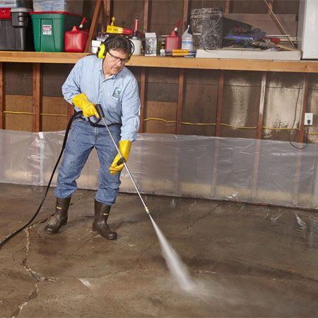 <b>Photo 1: Start with a clean floor</b></br> Scrub with a concrete degreaser and a stiff brush, then follow up with a pressure washer. Rinse twice to remove all residue.
