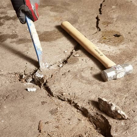 <b>Photo 3: Remove the loose stuff</b></br> Chisel away any loose fragments along cracks or craters; there's no need to bust away concrete that's firmly attached.