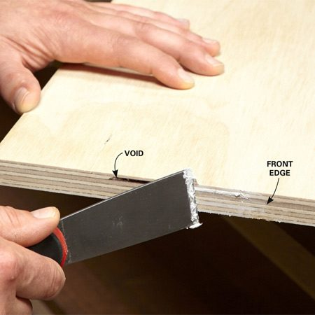 <b>Photo 1: Fill plywood voids</b></br> Figure out which edge will be exposed on each part, and fill any voids in the plywood. When the filler dries, sand the edge with 100-grit sandpaper.