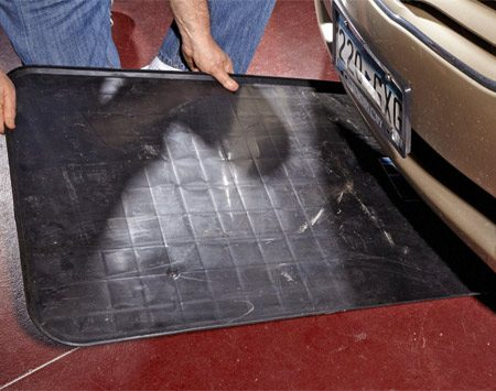 <b>Keep your floor clean</b><br/>Car repair is a messy business, and if you don't use a drip pan or a large piece of cardboard, you'll wind up with an oily mess on your garage floor. If you're the kind of cheapskate who saves appliance boxes just for this purpose, more power to you. But the rest of you can easily afford to buy a real drip pan with a lip all around the edge. When you're done, just pour the oil into your recycling bottle and put the pan back under your car to catch any remaining drips.
