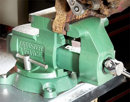 <b>A good investment</b><br/>A wimpy $30 vise may satisfy your wallet, but you'll regret buying one the first time you have to crank the bolts off a really big part. So skip the cheapies and invest in a heavy-duty vise. You want a vise with at least 5-1/2-in. jaws, a pipe clamping area, dual swivel locks and a large anvil area. I found this Masterforce model at a home center for $100. But you can find great deals on good used vises on Craigslist or at neighborhood garage sales.