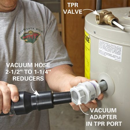<b>Apply suction</b></br> Remove the temperature pressure release valve and screw in the vacuum adapter. Attach the shop vacuum hose and fire up the vacuum.