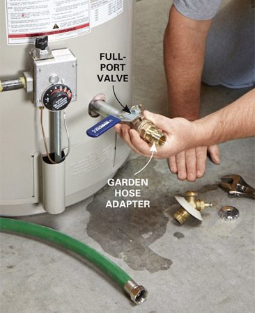 <b>Install the new valve</b></br> Unscrew the old drain valve and install the full-port valve (closed position). Attach one end of the garden hose to the valve and run the other end into a colander and on to the floor drain.