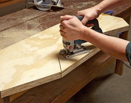 <b>Photo 3: Cut two at a time</b></br> Clamp two sides down and cut them both at the same time. That way, if you make any small cutting errors, the pair of sides will still match up. Make most of the cut with a circular saw, and then finish it off with a jigsaw.