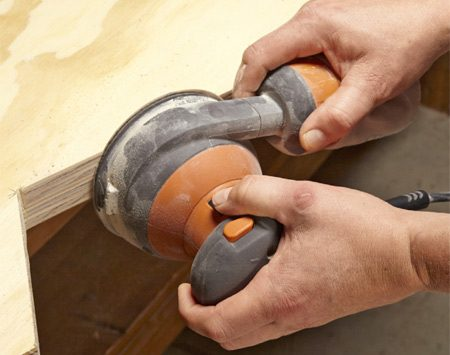 <b>Photo 4: Sand at a time</b></br> Smooth out the cuts before you unclamp the sides. Make sure to keep each pair together when you assemble the bins.