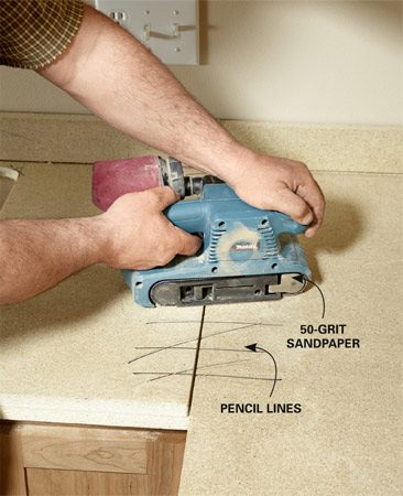 <b>Flatten problem spots</b><br/>There can be a small gap between the underlayment boards, but the seam has to be absolutely flat. Mark the seam with a pencil, then sand with 50-grit paper until the lines disappear.