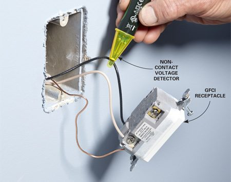 <b>Photo 4: Make sure the power is off</b></br> <p>Hold a noncontact voltage tester near each wire to make sure the power is off before you do any work on the wiring.</p>