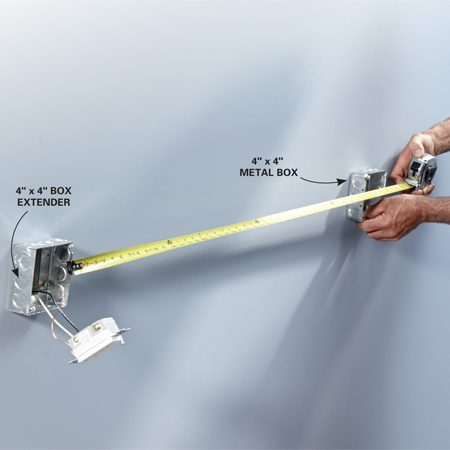 <b>Photo 5: Measure for conduit</b></br> <p>Screw a box extender to the existing electrical box. Then hold the next box in position and measure between them. Subtract 1/2 in. for the male adapters to determine the length of conduit needed.</p>