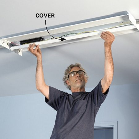 <b>Photo 15: Install the cover</b></br> <p>Finish the lighting installation by snapping the cover under the tabs. Then add the fluorescent lamps. Our fixtures also included a prismatic lens that we snapped on to complete the project.</p>