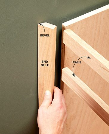 Make the face frame stile against the wall a little wider so it can be removed and scribed to fit.